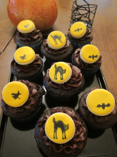 Spooky cupcakes with mini cookie disk decoration...