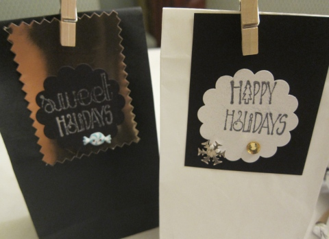 simple paper bags with decorative label and closed with a cute miniature cloth pin...