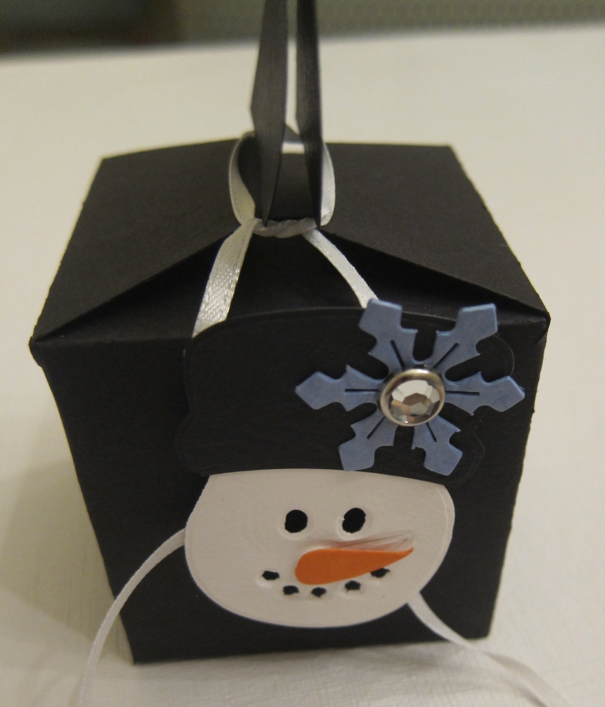 small black paper box decorated with a snowman...