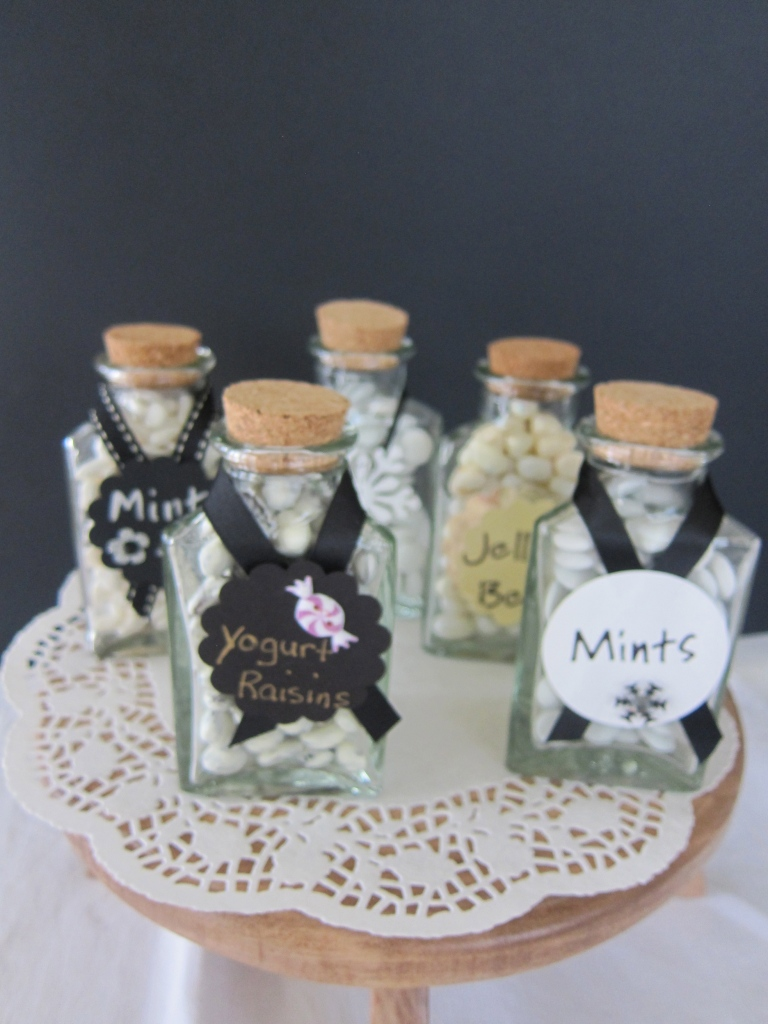 "Glass bottles filled with candy and ""sealed"" with ribbon and pretty label!"