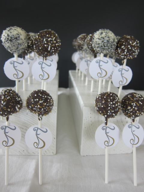 Glamorous cake pops in black, gold, silver and white...with a custom logo!