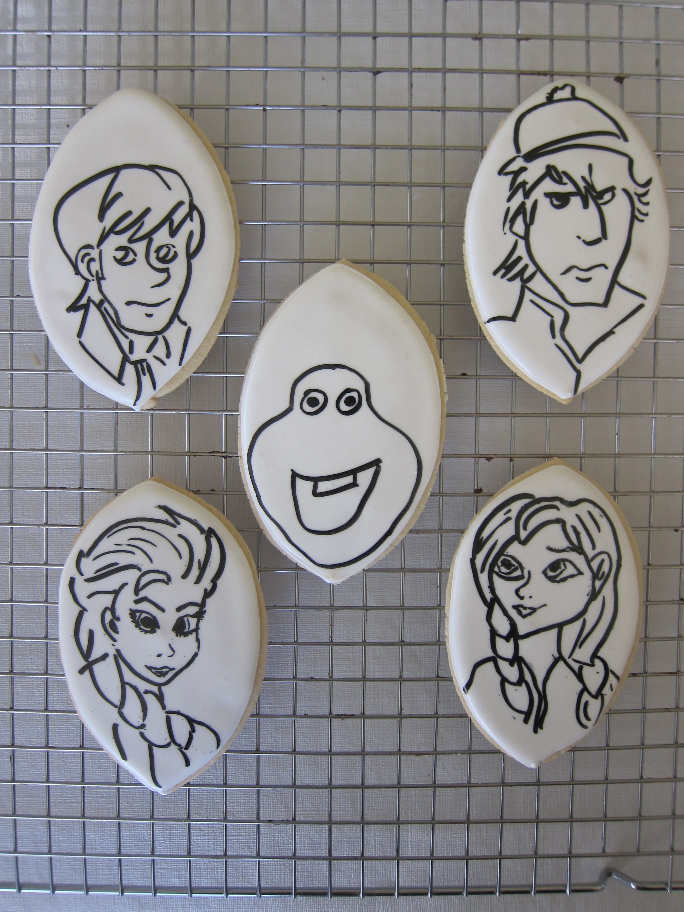 hand drawn faces of the characters, with black edible ink marker