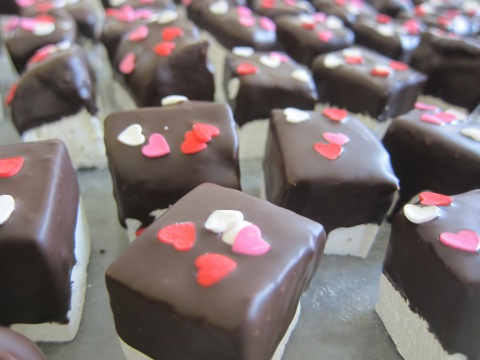 Chocolate-dipped marshmallows, ready to be shipped